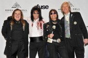 Dennis and the Alice Cooper group with the Hall of Fame trophy, R.I.P. Glen