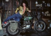 Jackie Fox lookin hot in her garage on a Triumph