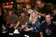 Producer Mike Clink, photographer Jack Lue and Vicky with the entire RECKLESS ROAD book panel