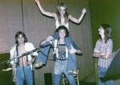 Drew, Randy, Kevin and Kelly horsing around in the studio by Ron Sobol