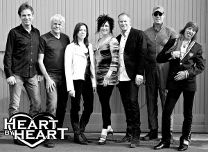 Steve, third from right, standing next to his girlfriend Somar Macek and the current lineup of Heart By Heart