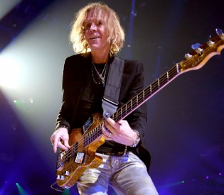 Aerosmith Bassist Tom Hamilton On New Blu-Ray/DVD Release, Band's Copacetic Chemistry And Obscene Plush Toys