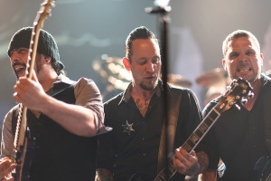 Rob Caggiano, Michael Poulsen and Anders Kjolholm of Volbeat, photo by Todd Reicher for LRI